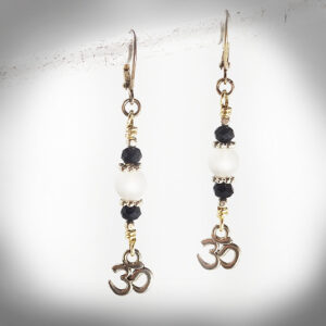 Hand-crafted quartz and crystal earrings with Om symbol charm